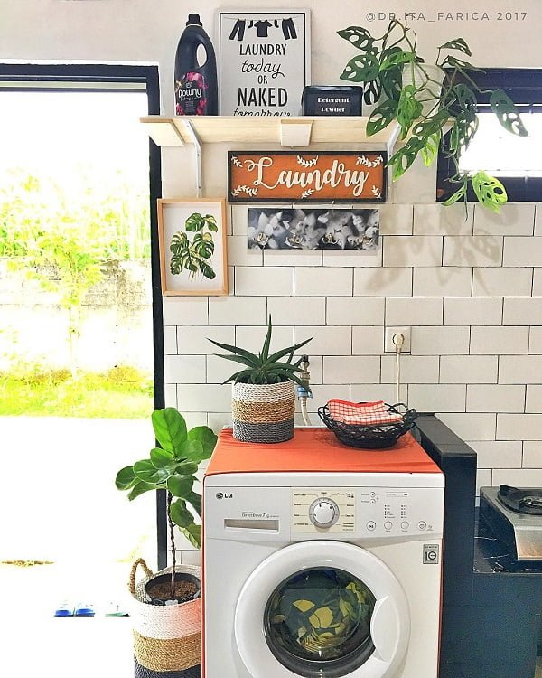 100 Fabulous Laundry Room Decor Ideas You Can Copy - Check out this laundry room decor idea with plants. Brilliant! #LaundryRoomDesign #HomeDecorIdeas