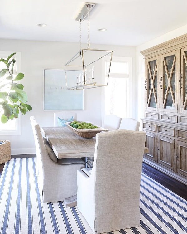 Love the striped nautical rug in this   decor