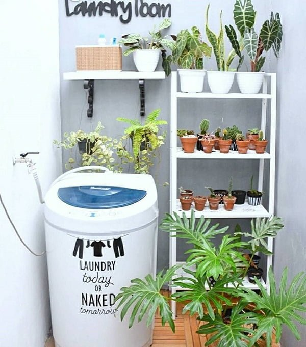 100 Fabulous Laundry Room Decor Ideas You Can Copy - Check out this laundry room decor idea with planters. Love it!