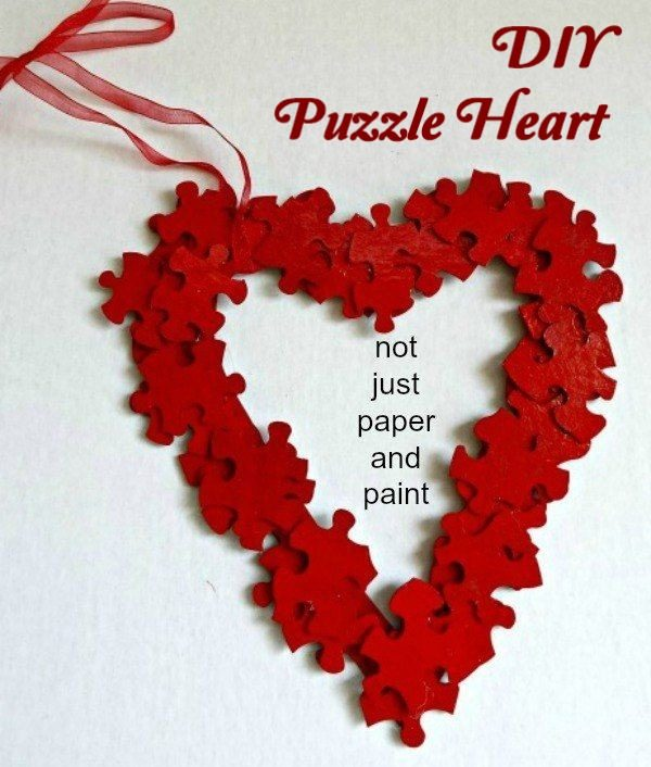Check out this easy idea on how to make a #DIY puzzle piece heart for #ValentinesDayDecor #ValentinesDayCrafts #ValentinesIdeas
