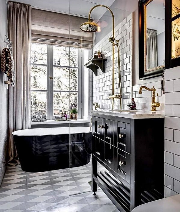 Going for the classy look with subway tile and black cabinets with metallic accents. Love this!