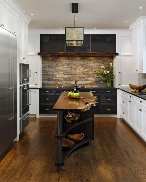 Check out this unusual kitchen design with natural wood countertops and plank backsplash. Love it!