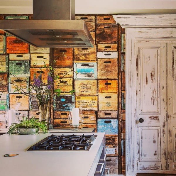 Check out this unusual kitchen design with crate box wallpaper. Love it! #KitchenDecor #KitchenDesign #HomeDecorIdeas