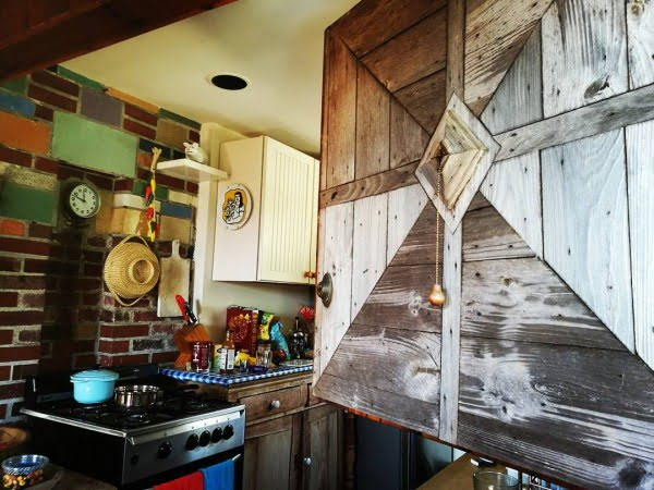 Check out this unusual kitchen design with rustic farmhouse accents. Love it!