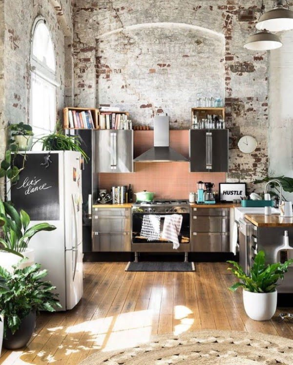 Check out this unusual kitchen design with exposed brick walls. Love it!