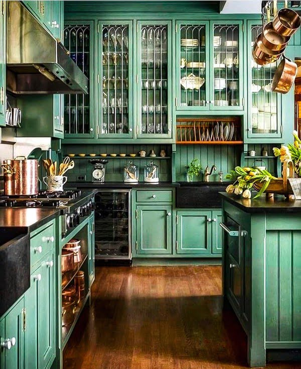 Check out this unusual kitchen design with green eclectic cabinets. Love it!