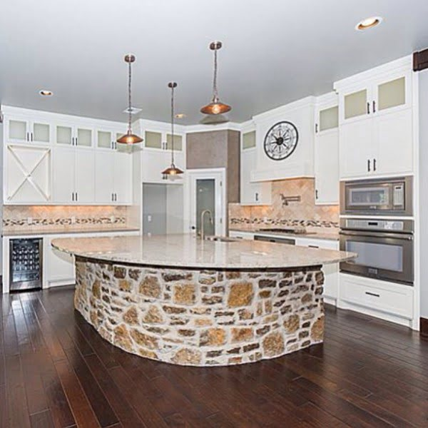 Check out this unusual kitchen design with a masonry island counter. Love it! #KitchenDecor #KitchenDesign #HomeDecorIdeas