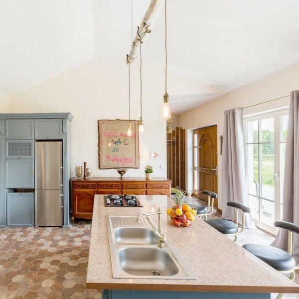 Check out this unusual kitchen design with branch beam light fixtures. Love it!