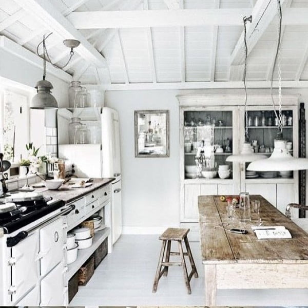 Check out this unusual white washed farmhouse kitchen design. Love it!