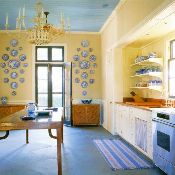 Check out this unusual kitchen design in a bright yellow and pale blue palette. Love it!