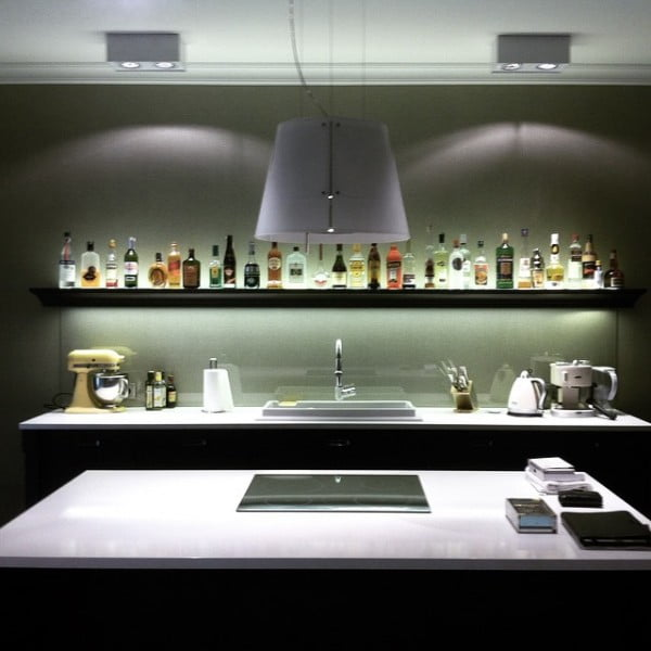 Check out this unusual kitchen design with a bar shelf backsplash. Love it!