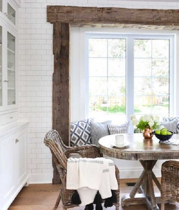 Love the wood beam accents and the   decor in this living room dining area