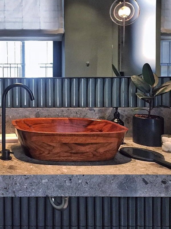 A wooden sink is a brilliant accent in  decor. Love this!