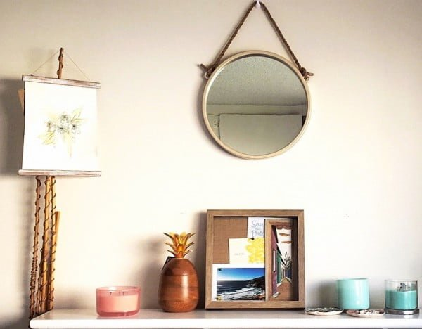 California chic decor idea with a nautical accent mirror. Love it!