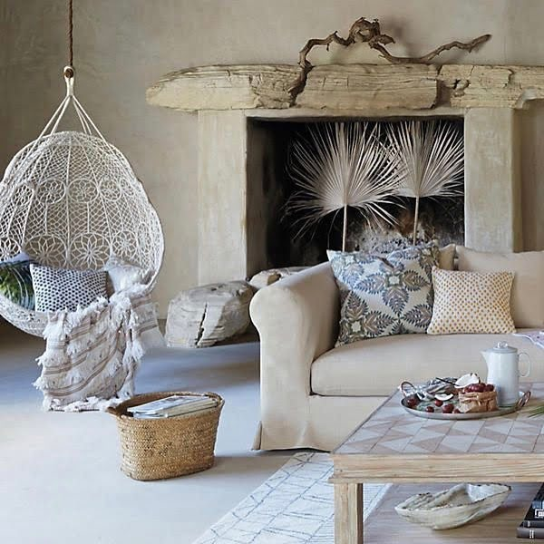 California chic decor idea with a hanging chair. Love it!
