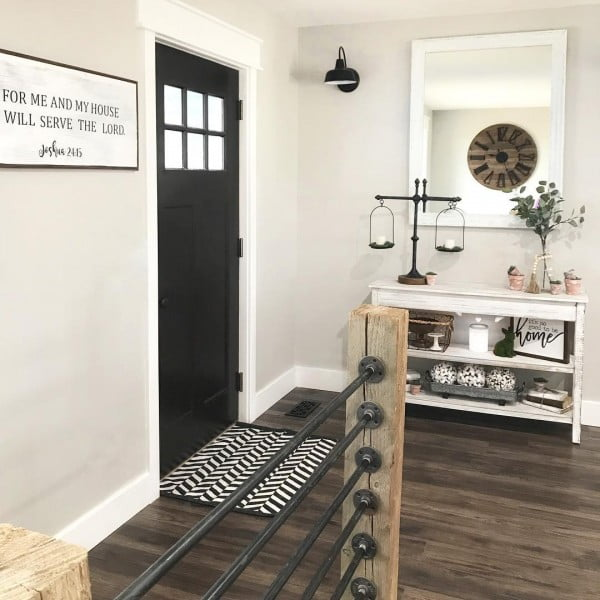Check out this  entryway decor idea with a mirror and an oversize clock. Love it!