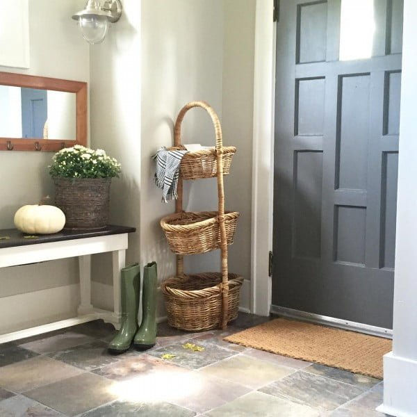Check out this  entryway decor idea with a tiered wicker basket. Love it!