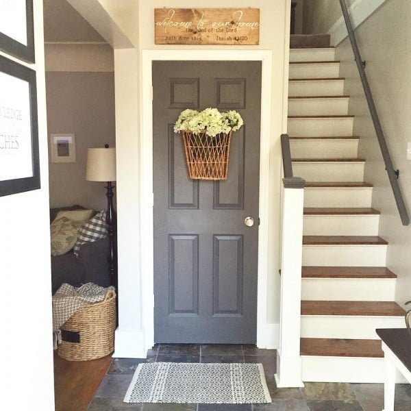 Check out this  entryway decor idea with a basket door wreath. Love it!
