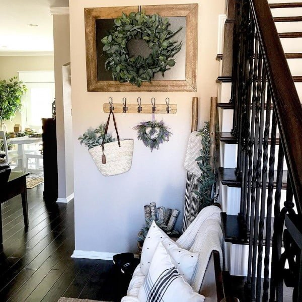 Check out this  entryway decor idea with a framed wreath. Love it!