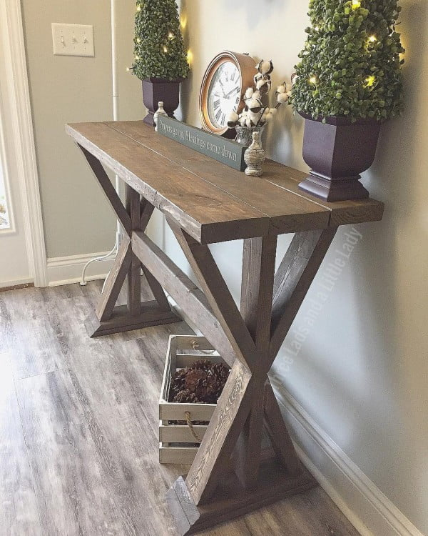 Check out this  entryway decor idea with a  x-base table. Love it!