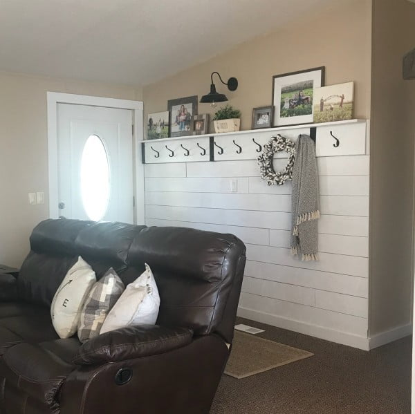 Check out this  entryway decor idea with a coat hanger shelf. Love it!