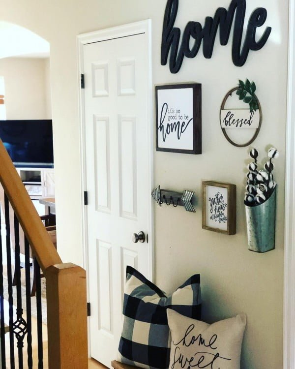 Check out this  entryway decor idea with home signs. Love it!