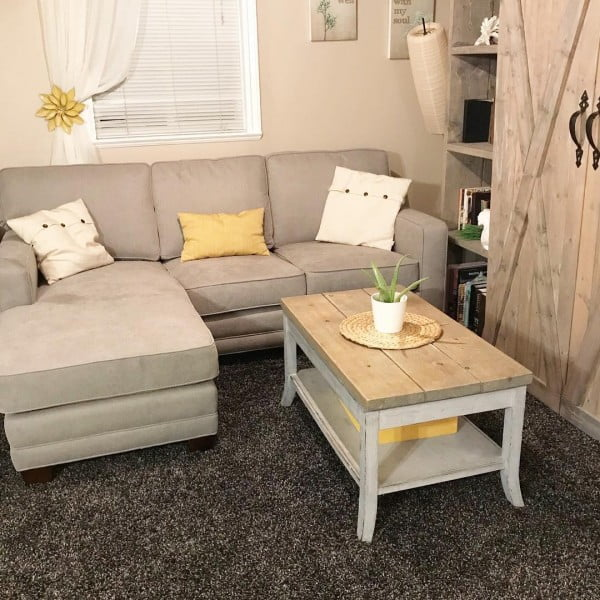 living room decor idea with a solid wood coffee table and a barn door bookshelf. Love it!