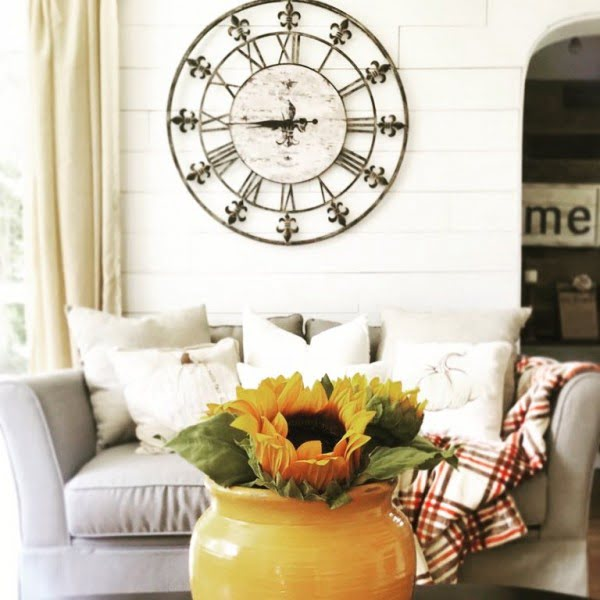 living room decor idea with an oversize wall clock. Love it!