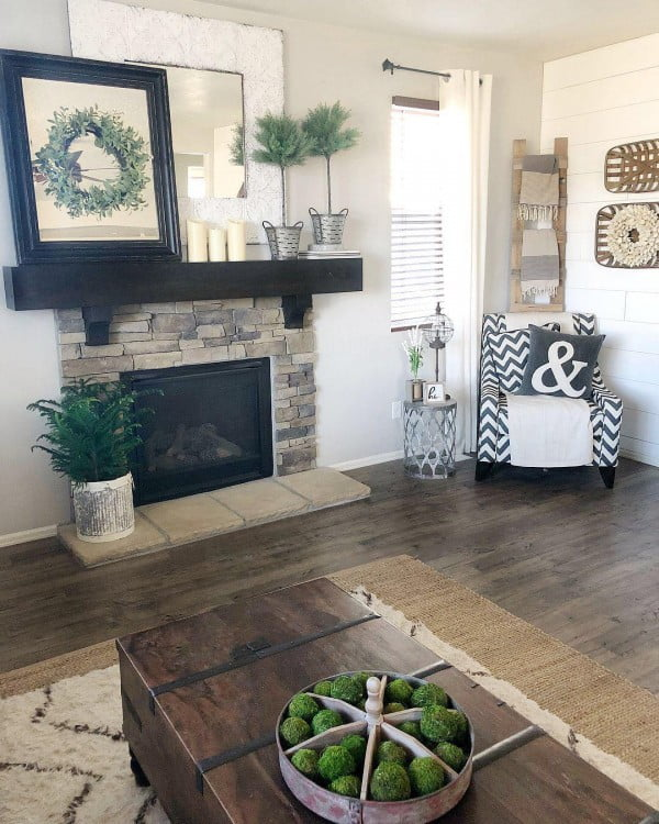 living room decor idea with rustic mantel and coffee table. Love it!