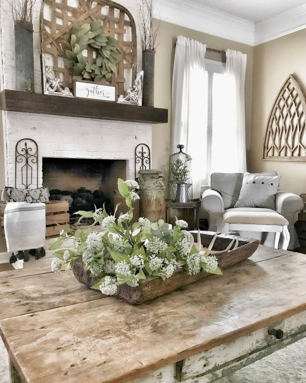 living room decor idea with a rustic table and farmhouse signs. Love it!