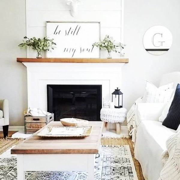 living room decor idea with a rustic coffee table and mantel decor. Love it!