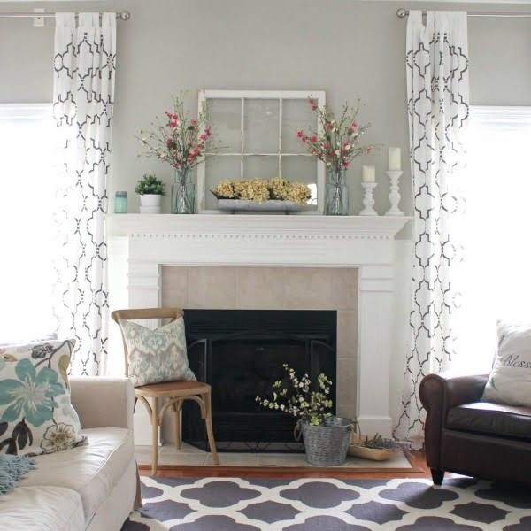 living room decor idea with old window frame mantel decor. Love it!