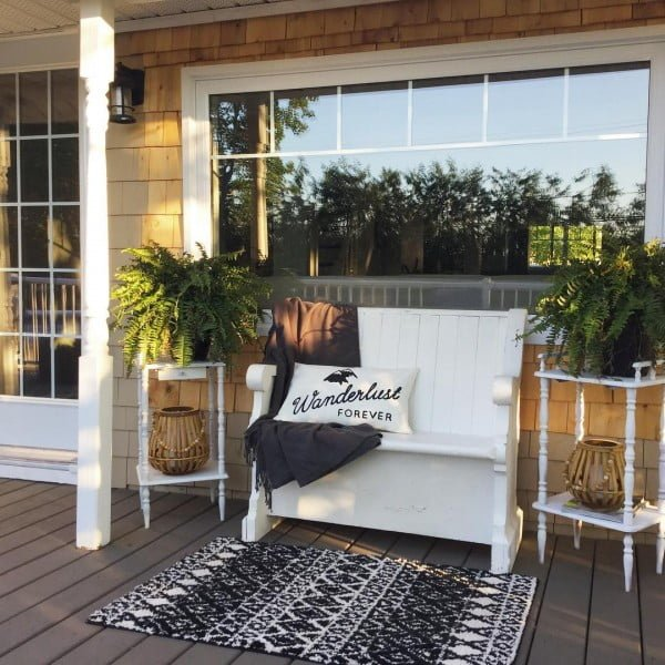 Check out this  porch decor idea with a seating area. Love it!