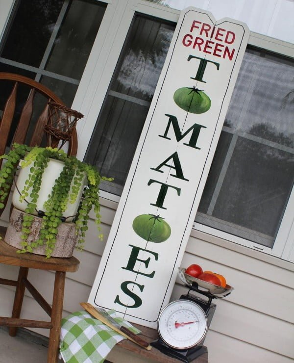 Check out this  porch decor idea with vintage sign. Love it!