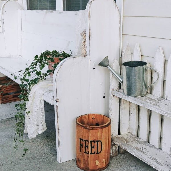 Check out this  porch decor idea with a vintage bench and decorative bucket. Love it!