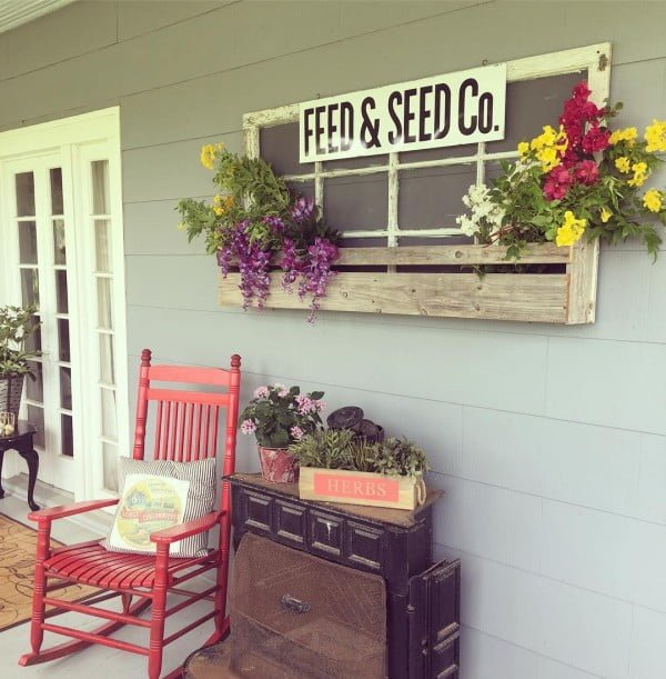 Check out this  porch decor idea with a repurposed old window frame. Love it!