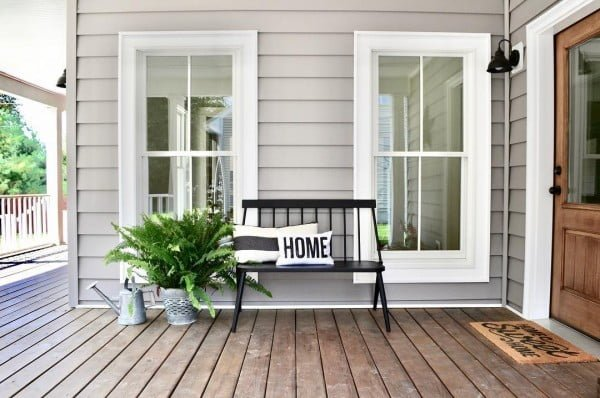Check out this  porch decor idea with a bench and throw pillows. Love it!