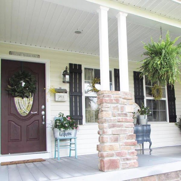 Check out this  porch decor idea with flower stands. Love it!