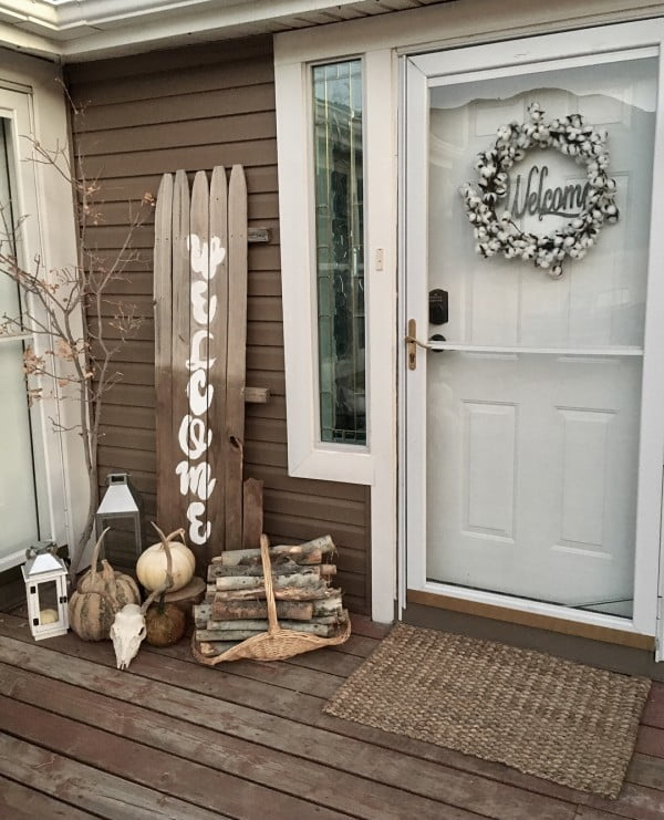 Check out this  porch decor idea with a repurposed sign. Love it!