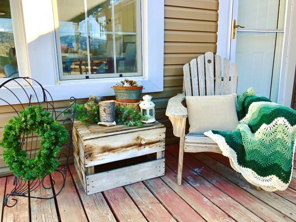 Check out this  porch decor idea with rustic and repurposed furniture. Love it!