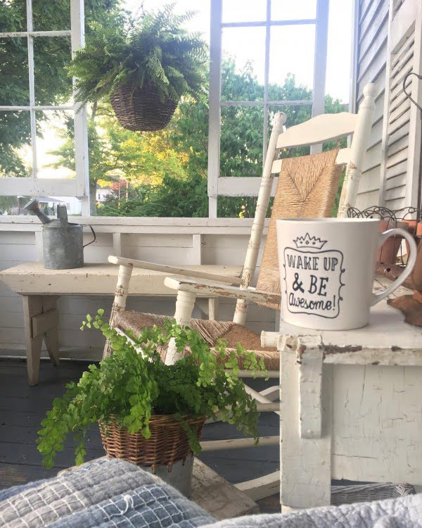Check out this  porch decor idea with weathered vintage furniture. Love it!