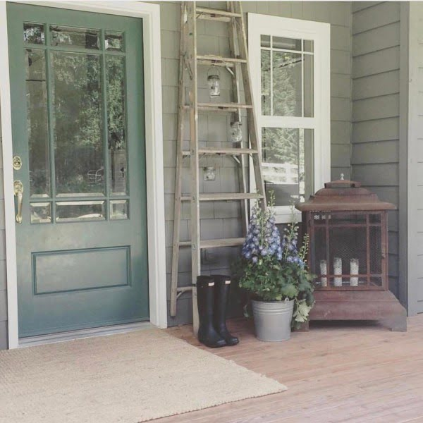 Check out this  porch decor idea with a  vintage ladder. Love it!