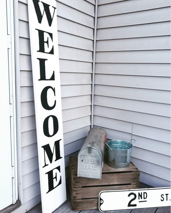 Check out this  porch decor idea with a large scale welcome sign. Love it!