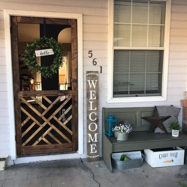 Check out this  porch decor idea with  storage boxes. Love it!