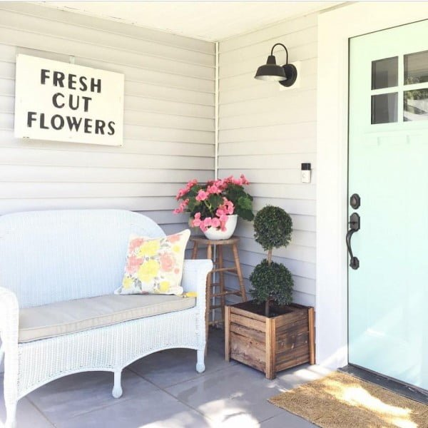 Check out this  porch decor idea with wicker furniture. Love it!