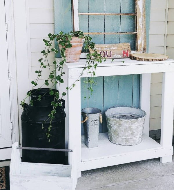 Check out this  porch decor idea with a vignette from repurposed wood. Love it!