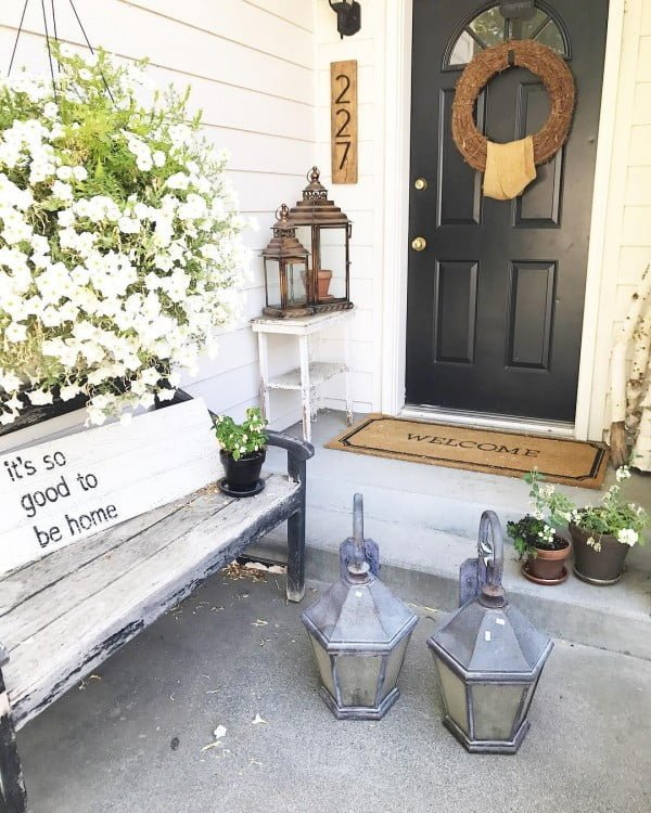Check out this  porch decor idea with a  bench, wreath and a welcome mat. Love it!