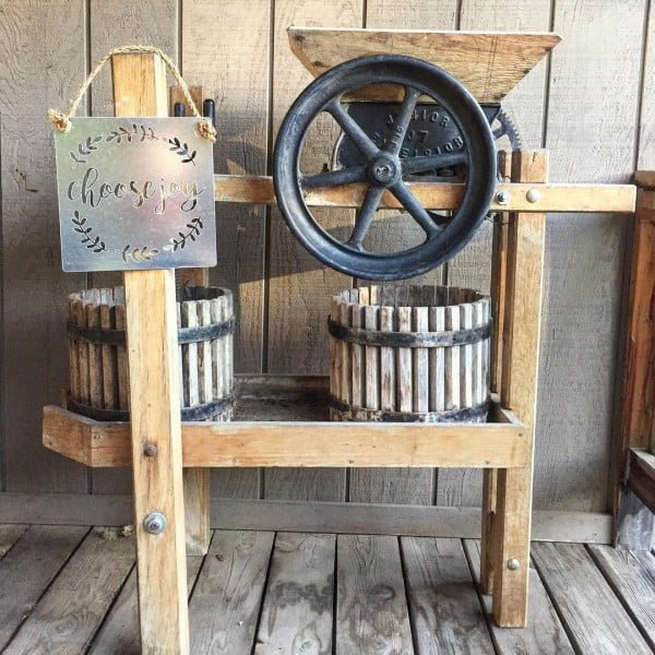 Check out this  porch decor idea with vintage farmhouse equipment. Love it!