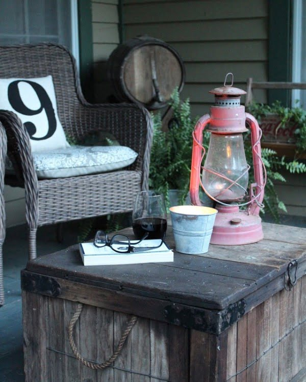 Check out this  porch decor idea with a crate table and vintage lantern. Love it!