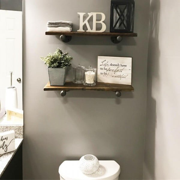 100 Cozy Rustic Farmhouse Bathroom Decor Ideas You Can Easily Copy - Check out this #rustic bathroom decor idea with wood and pipe shelves. Love it! #BathroomDesign #HomeDecorIdeas